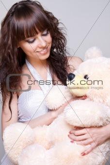 beautiful girl with a teddy bear