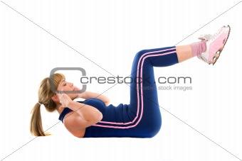 Girl exercising on the floor