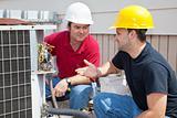 AC Technicians Discuss Problem