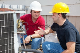 AC Technicians Discuss Problem