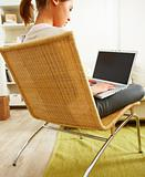 Woman sitting on a chair and using laptop