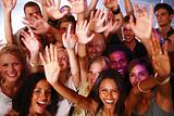 Group of young friends waving together in nightclub