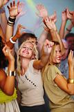 Joyful young people partying in a club