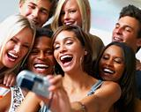 Joyful group of young people taking self portrait