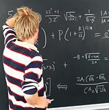 Student looking at blackboard