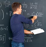 Student solving algebra on blackboard