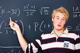 Education - Young man demonstrating algebra