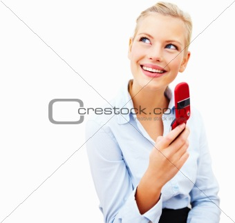 Smiling young businesswoman holding cellphone