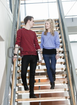 Couple walk the stairs