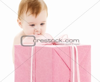 baby boy with big gift box