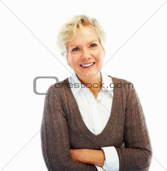Portrait of a cheerful old woman standing with her hands folded on white background