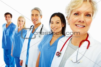 Hospital staff standing in a row over white