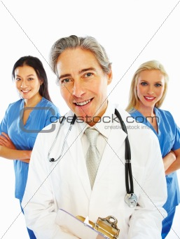 Cheerful doctor standing with female colleagues against white background