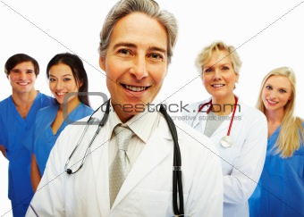 Confident doctor with other colleagues at the back