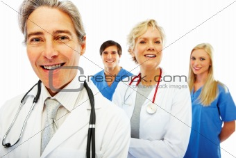 Group of happy doctors standing against white