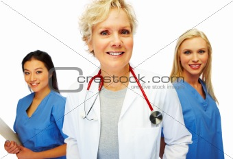 Mature doctor with female colleagues
