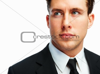 Handsome young businessman looking away