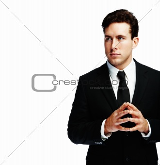 Confident young businessman against white