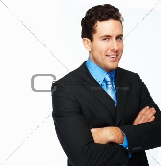 Smiling young businessman against white