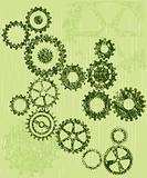 Grunge cogs / gears on a green background
