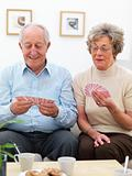 Old couple playing a game of cards