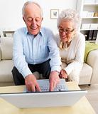 Senior couple working together on a laptop