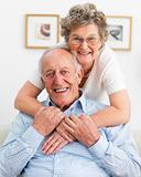 Smiling old couple hugging each other