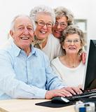 Old people working at home on computer