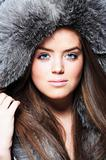 Beautiful girl wearing furs