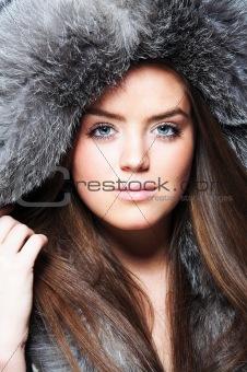 Beautiful girl wearing furs