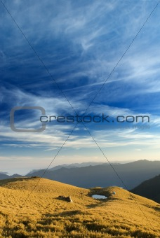 beautiful clouds fly over the grassland in high mountain.