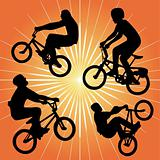 silhouette of bmx riders on an orange background.