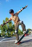 Boy Balancing on Skateboard