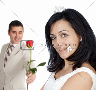 attractive boyfriend offering a rose to his bride