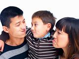 Asian family making funny faces on white