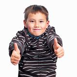 Smiling boy showing thumbs up sign