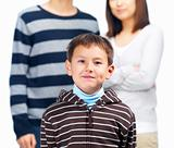 Portrait of a boy standing with parents