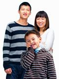 Happy asian child  holding his cheek with parents