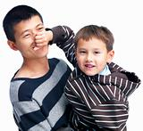 Boy squeezing his father's nose