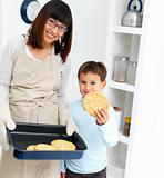 Mother and son baking cookies at home
