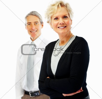 Smiling senior woman with man in background