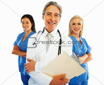 Old doctor with female colleagues at the back