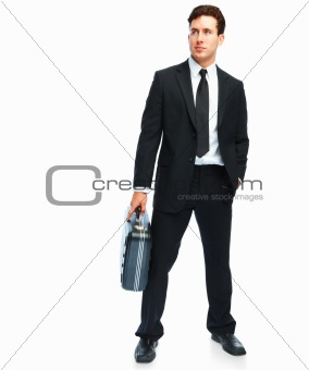 Portrait of a successful and confident young business man carrying a suitcase on white background