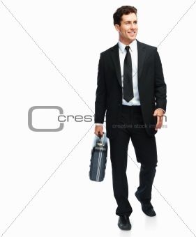 Portrait of a happy and confident young business man carrying a suitcase on white background