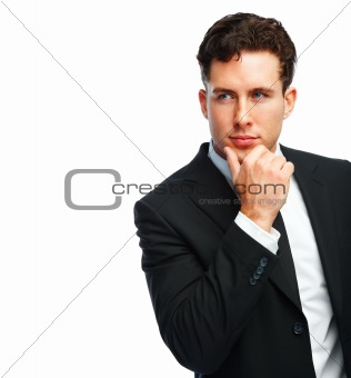 Portrait of a successful young business man contemplating on white background