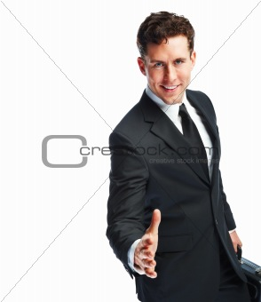 Portrait of a young business man smiling and extending a hand for a shake