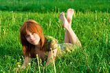 Young beautiful girl lying on the grass