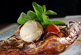 vanilla ice-cream with a baked apple strudel