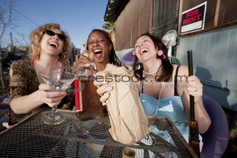 Three women drinking alcohol