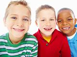 Portrait of three smiling young boys over white background
